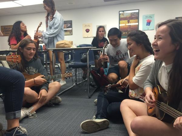 The Ukulele club members play with their instruments (Staff Photographer/Talon).