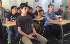 Members of the Kiva Club play Super Smash Bros. Brawl to raise money for third-world countries. The weeklong tournament fundraiser attracted 27 participants and many more spectators (Carly Albert/Talon.)