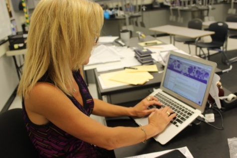 Biology teacher Winnie Litten prepares for her class using the new Google Classroom technology. This technology is being implemented schoolwide in order to go paperless and prepare students for the job market (Staff Photographer/Talon).