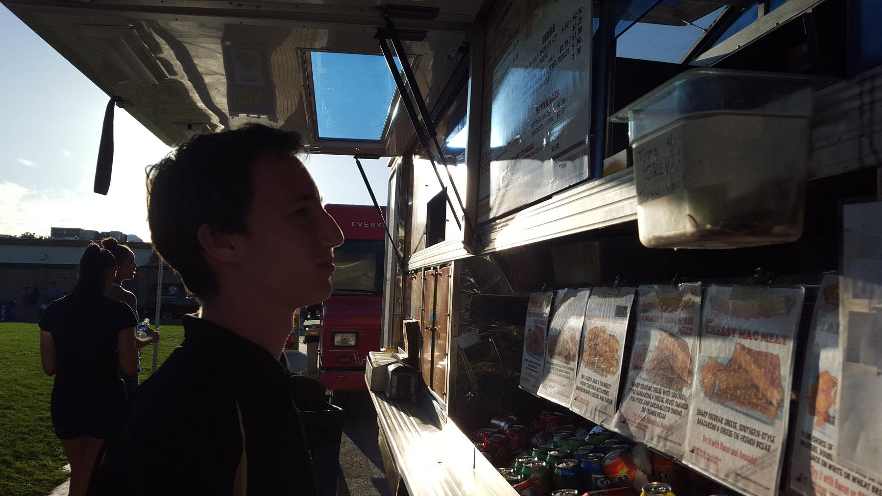 A student decides what he is going to buy from The Grilled Cheese Truck (Nick Burt/Talon)