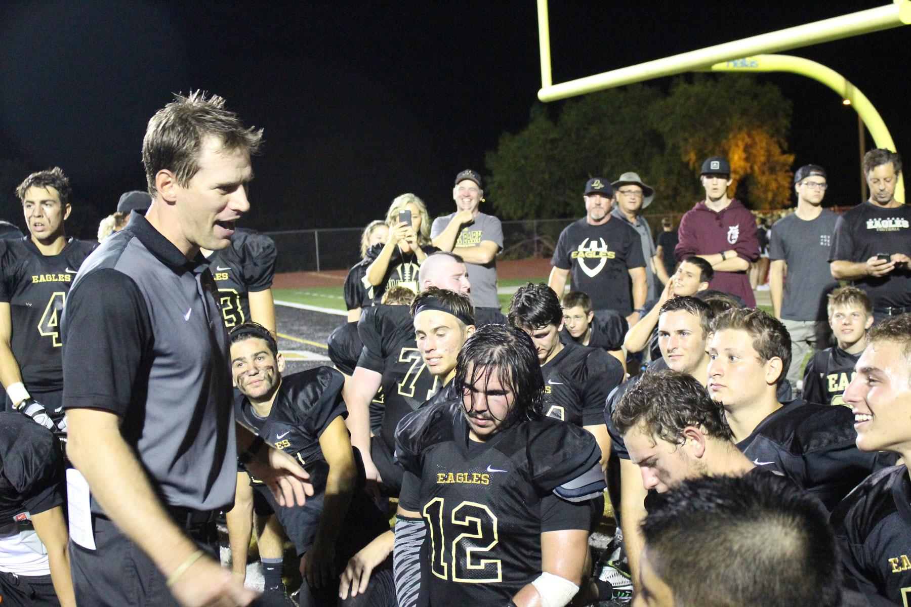 Football coach Tim Kenney congratulates the team after its win against Viewpoint (Photographs courtesy of Caitlin Fowler).
