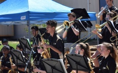The high school jazz band performs in the amphitheater at Medea Creek Middle School April 17. Performing along with the jazz band were the high school concert band, wind ensemble and choir (Meghana Mudunuri/Talon).