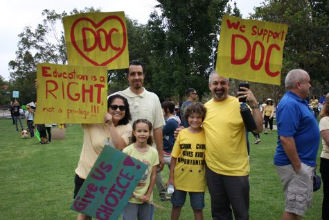 Families show their support for the renewal of the District of Choice program (Nick Burt/Talon).