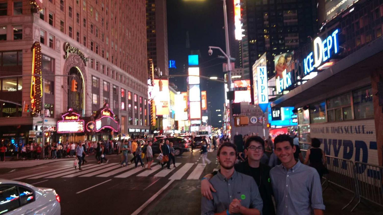 "Juniors Aiden Glikmann, left, and Benjamin Fuller, center, pose in Times Square. Glikmann and Fuller were invited to participate in the International High School Film Festival in New York City for their short- lm ""The Stall"" (photo courtesy of Ben Fuller)."