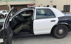 Officer David Diestal in his police vehicle.
