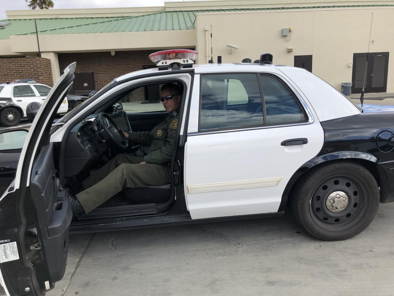 Officer David Diestal in his police vehicle.