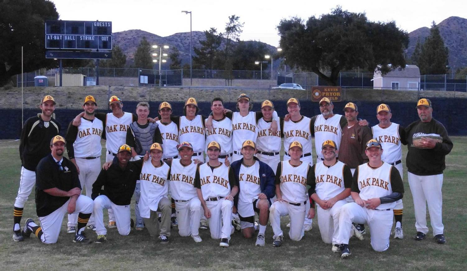 The Varsity Baseball team poses after winning their opening tournament