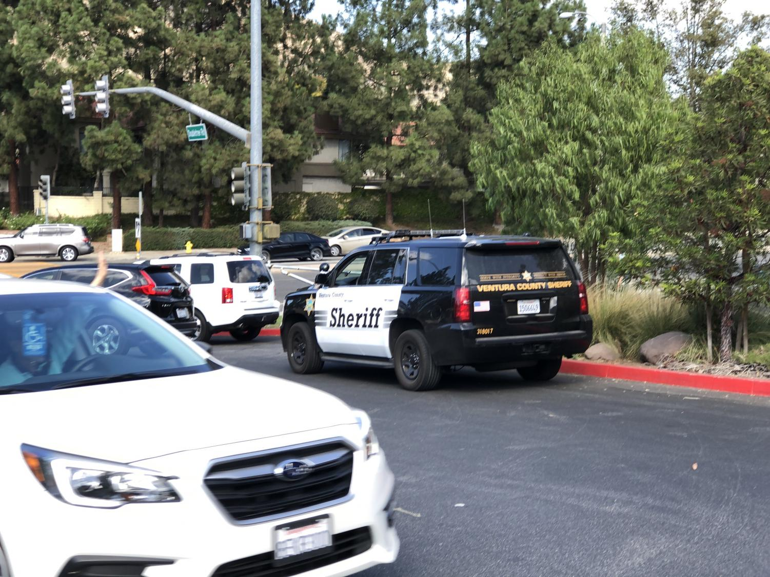 Police cars at the Oak Park high school exit.