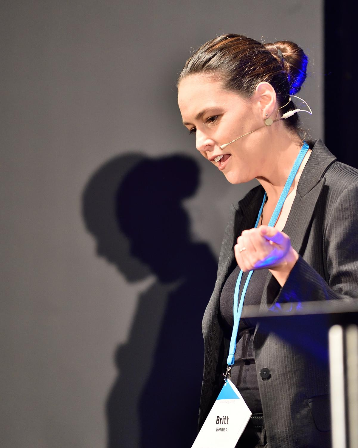 Britt Hermes gives a speech at the 2016 QED (Question, Explore, Discover