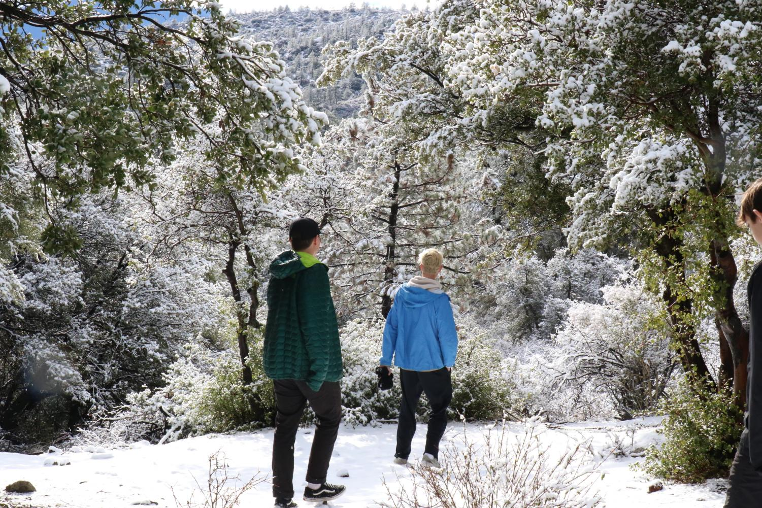 Seniors Marcus Jasso and Justin Jordan enjoy snow during the second Life Skills Retreat at Angeles Crest Christian Camp during recreation time