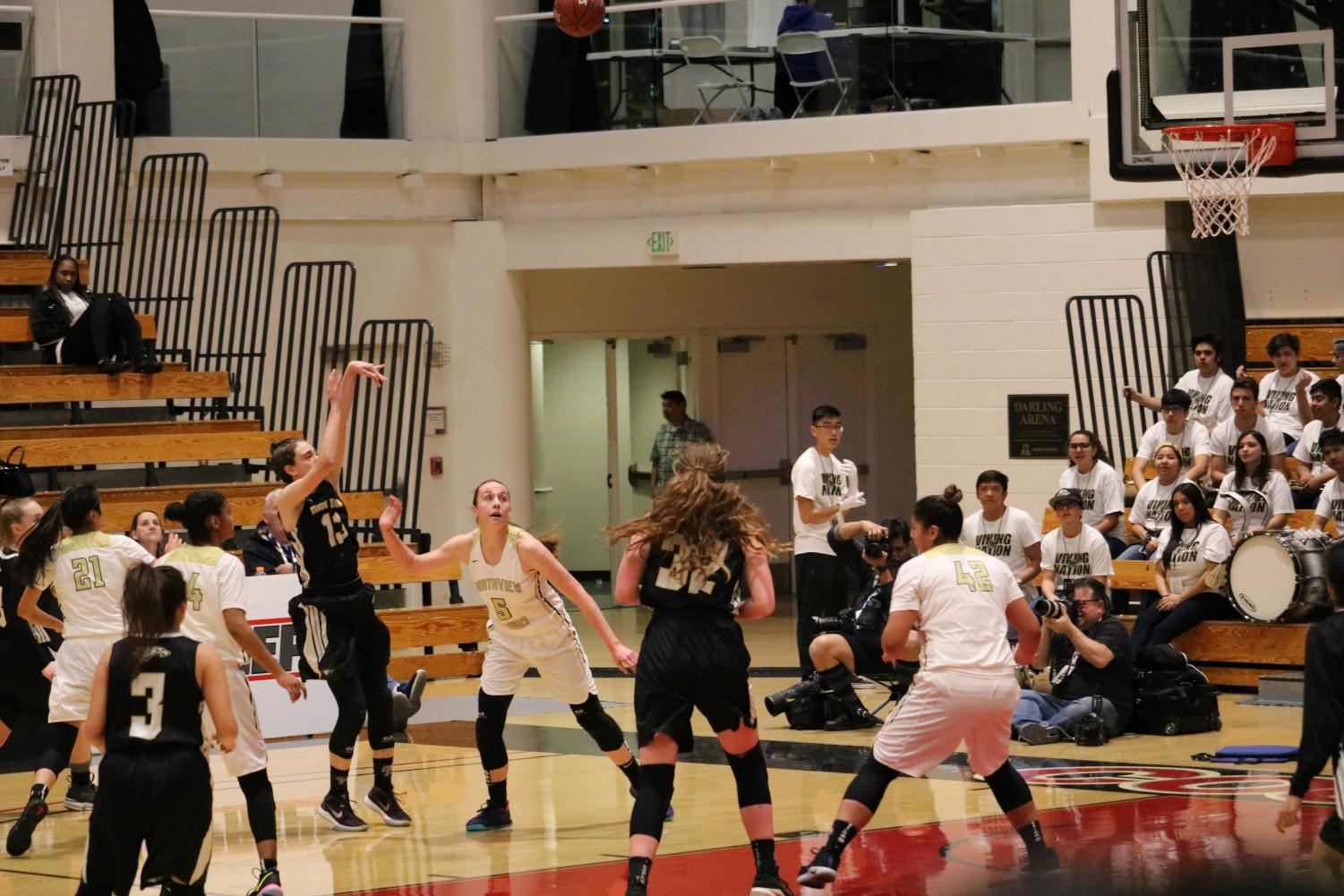 Junior Mia Foresti shoots while Northview senior, Autumn Rivera, attempts to block the shot. Girl's varsity basketball  lost the CIF final game but advanced to State Playoffs