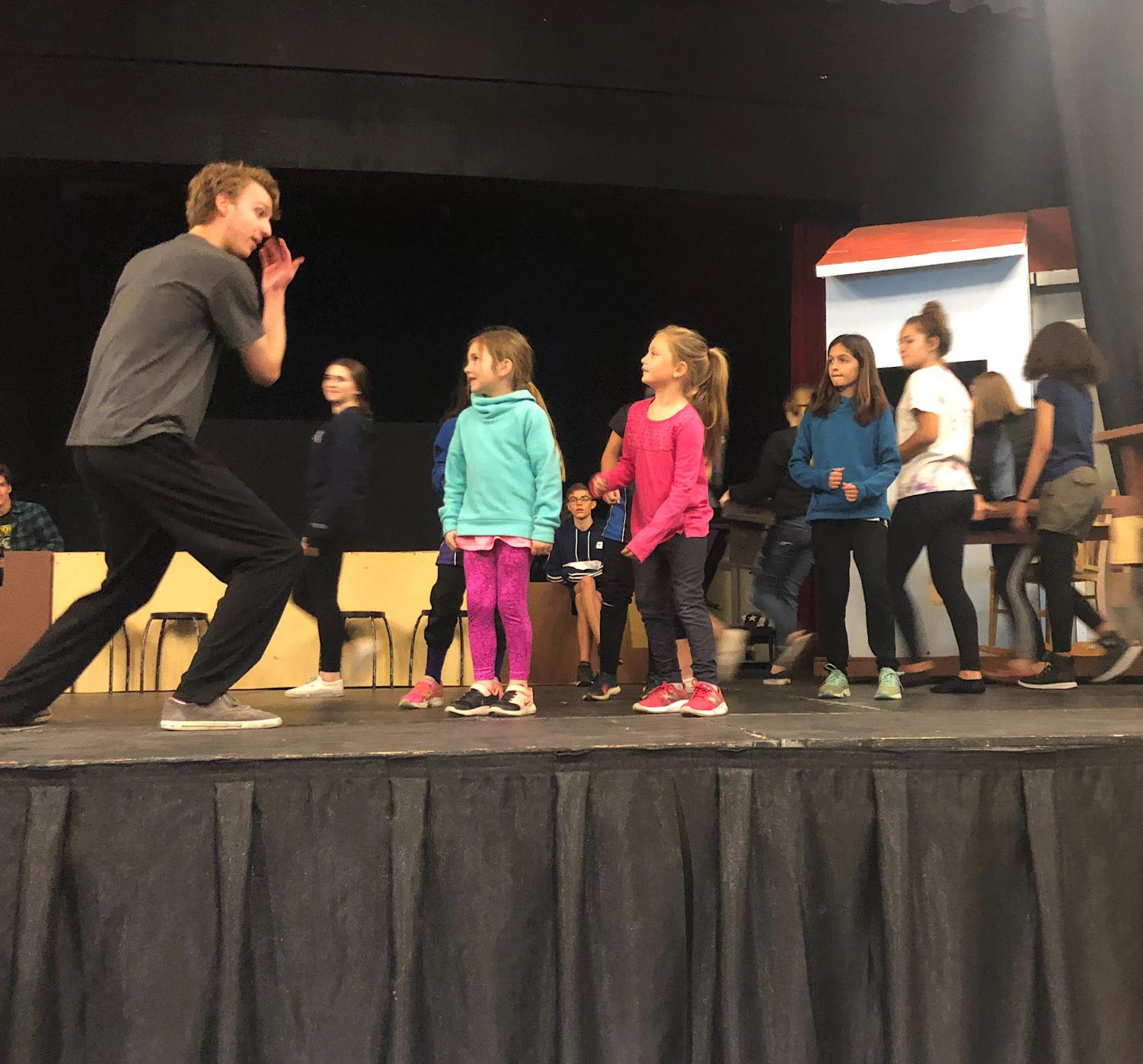 Jeremy Orriss performs along side students form local elementary schools during practice for the spring musical,