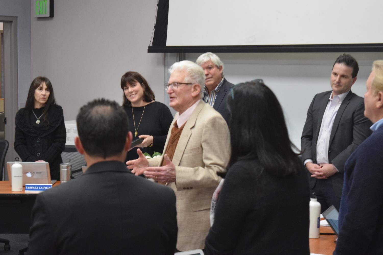 Manny Fischman recognized at February board meeting by Board of Education members Tony Knight, Denise Helfstein, Barbara Laifman, Drew Hazelton, Allen Rosen and Derek Ross.