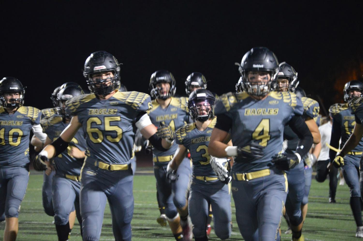 With a new defense system under their belts, the varsity Eagles have become undefeated league champions with their 9-0 record during the season.