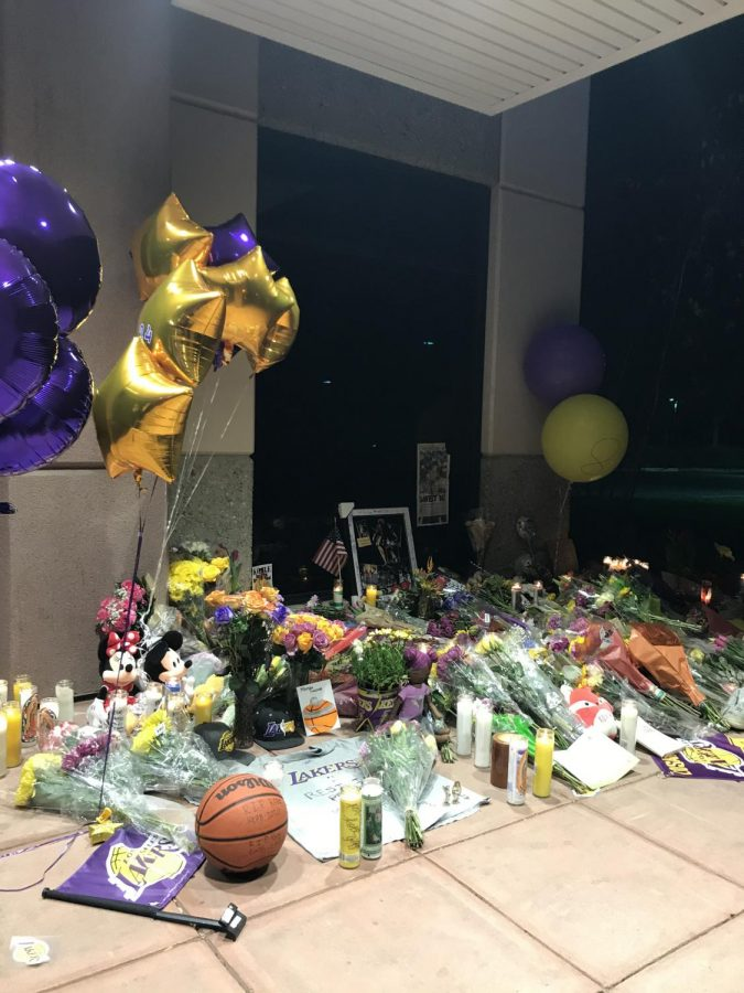 Fans+leave+flowers+and+mementos+on+Mamba+Sports+Academy%27s+doorstep+in+memory+of+those+lost+in+helicopter+crash+Jan.+26