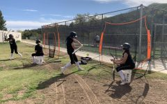 Two seniors lead softball team with a new culture