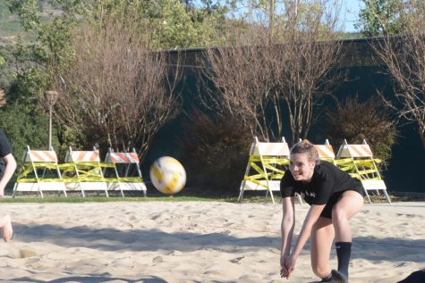 On an ordinary Tuesday practice, Payton dives to save a ball from a sandy embrace. Payton's athleticism allowed her to quickly adjust to her new sport