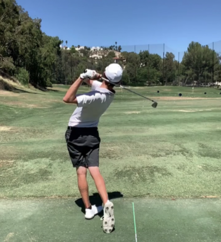 Senior Kelly Dobson swings to hit a golf ball at the Calabasas Country Club.
